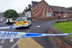 Police on the scene in Mount Pleasant, Houghton, following an aggravated burglary.