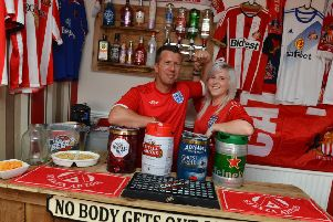 Steven Simpson and wife Cassie World Cup home bar.