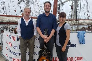 From left to right: Co-artistic director Paul Emerson, singer Barry Hyde and co-artistic director Kathryn Pilkington.