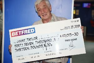 Jimmy Taylor with his winning cheque