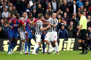 Wilfried Zaha (centre) clashes with Kenedy in a rare moment of excitement at Selhurst Park.