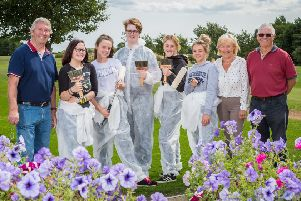 Youngsters from Houghton Golf Club have got together to redecorate the clubhouse.