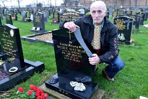 Jimmy Smart at the damaged grave of his late brother William Alan Smart. Picture by FRANK REID