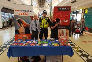 PC Chris Pennock with community engagement team members Sally College (right) and Paul Marshall (left) in the Bridges with Russell.