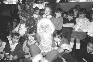 Santa with his adoring young fans in 1986.