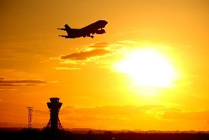Another flight leaves Newcastle International Airport.