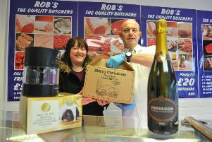 Food hamper prize draw winner Linda Wilkinson receives her prize from butcher Rob Robson.