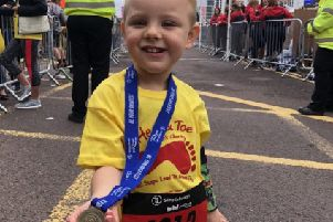 Hunter is so proud after completing the Mini Great North Run
