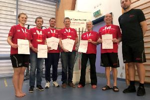 Left to right: Imogen Fife, Ian Whyte, Mark Robinson, Dave Hills, Lindy Woodrow, Norman Stephenson and coach Constantin Cosmin Petcu.