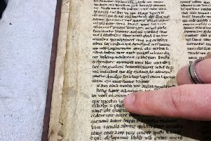 Undated University of Bristol handout photo of a detail showing the name Merlin in a hand-written parchment fragment of a manuscript from the Middle Ages which tells the story of Merlin the magician.