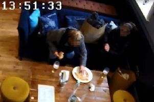 The pair can clearly be seen adding the hair to the pizza.