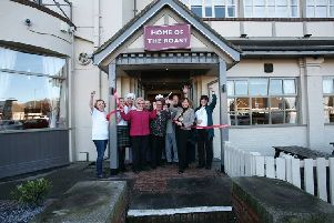 Mayor of Sunderland Lynda Scanlan and staff from St Benedict's Hospice cutting the ribbon at Barnes Carvery