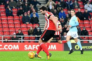 Will Grigg misses a great chance against Accrington Stanley.