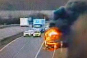 A car on fire on the side of the A1. Pic courtesy of Highways England.