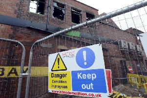 A cordon remains around the former Peacocks site, seen here from the rear of Blandford Street.