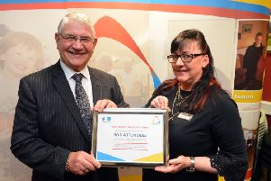 Durham Police Crime and Victims' Commissioner Ron Hogg presents a certificate marking the 500th attendee milestone to  community job clubs project co-ordinator Lisa Taylor.