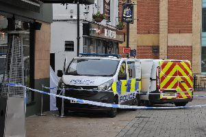 Police have sealed off part of the city centre while the murder investigation continues.