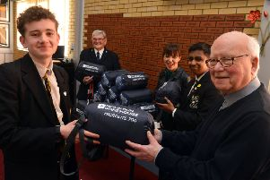 St Aidan's Catholic Academy students present sleeping bags to Churches Together for the homeless.