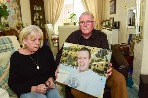 Linda and Dan Golden with a photograph of late dead Frazer.