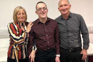 Andrew Duddin with his parents Chris and Pamela.
