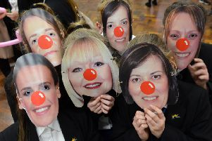 Red Nose Day fun at Farringdon Community Academy with pupils wearing teacher masks
