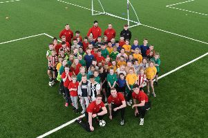SAFC u23 footballers Jack Connolly, Alex Storey and Jacob Young with pupils at the Beacon of Light with pupils from West Rainton Primary School.