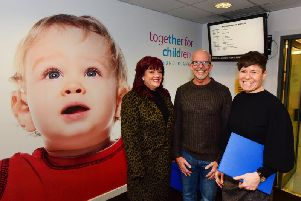 Jill Colbert, Chief Executive of Together for Children with foster carer, Debbie Collins and her partner Billy Lambert at the Sandhill Centre in Sunderland.