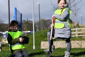 Lewis Wooton and Lola Hughes from St Patrick's School plant their trees in the grounds of St Benedict's Hospice in Ryhope.