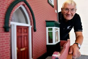 Wally Nanson next to the model house he made as replica of his former Roker Avenue home.