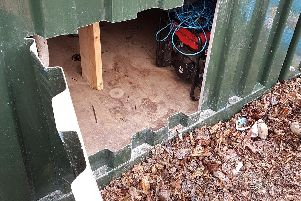 Thieves cut open the side of one of the containers to get in and steal tools.