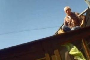 Rapist George Stephenson attempts to evade capture by climbing on to a roof.