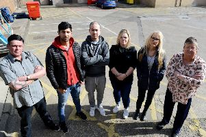 Traders (Left to right) Robbie Bleasdale, Umar Aktar, Nguyen Anh, Umar Akhtar, Stacey Sayers, Julie Tilley and Shelia Fusco standing at a service area, Castle Dene Shopping Centre Peterlee. Picture by FRANK REID