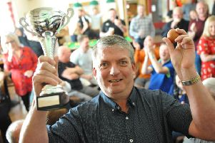Andy Dudgeon with the trophy he won at the World Egg Jarping Championship at the Hearts of Oak, Peterlee.