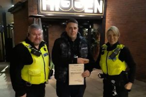 Anthony Hopper from Fusion/Hidden is given a commendation by Sergeant Maria Ord and PC Martin Brace.