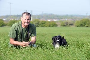 Peter Collins with dog Ted who found missing man George Dodds.
