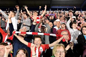 Sunderland AFC supporters celebrate at the final whistle at Fratton Park.