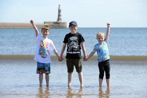 Children enyoing high temperatures at Roker Beach. From left Jacob Craister-Miller, seven, Harry Craister-Fawcett, 10, and Mia Craister-Corrigan, five.