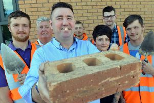 SJL Brickwork celebrates 20 years in business. MD Steven Lynn with team staff and apprentices