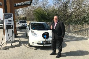 Coun Miller at the new charging station