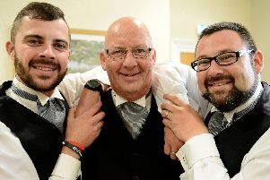 Stephen Laughton with his son's Craig (left) and Daniel at Strathmore House, Hartlepool. Picture by FRANK REID