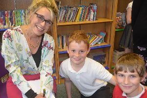 Sunday Times Bestselling author Nancy Revell with pupils Fabio, left, from Year five, and Jimmy, from Year six, talking to Nancy about her life as an author