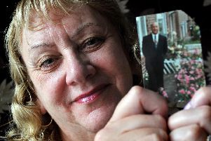 Karen Robson, pictured with a photo of her late husband Leslie Westcott, will be presenting medals at the World Transplant Games.