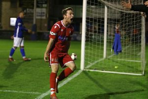 Chris Dawson celebrates his late winner at Matlock Town on Tuesday night. Picture by Richard Parkes.
