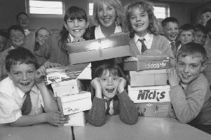 Northstead Junior School teacher Elaine Dunwell, top centre, and pupil Nataltie Woods, centre, organised a toiletries collection in shoeboxes to send to Croatia in March 1997. Pictured with their boxes are Jonathan Sleep, Emily Jones, Samantha Wilton and Craig Hugill.