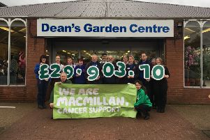 Dean's Garden Centre and MacMillan Cancer Support stuff jubilant with the sum raised.