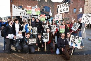 Students join an international protest to call for urgent action to tackle global warming.