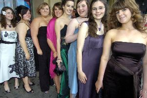 Looking glamorous arriving for the school prom.