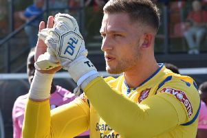 Boro keeper Tommy Taylor is 100% focussed on performing well for the club despite links to Football League sides