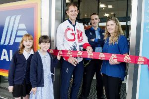 Opening of Aldi Store in Whitby by Olympic Rowing Champion Matthew Langridge.'Pictured cutting the ribbon with Emily Dugdale (left) and Madeline Anscombe from East Whitby Primary Academy, Syore Manager Stuart and Assistant Store Manager Sarah Noble.'Picture: Sean Spencer.