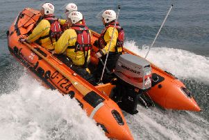 The coastguard was called and the inshore lifeboat launched to help rescue the man